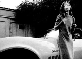 Joan Didion smoking leaned on her Stingray